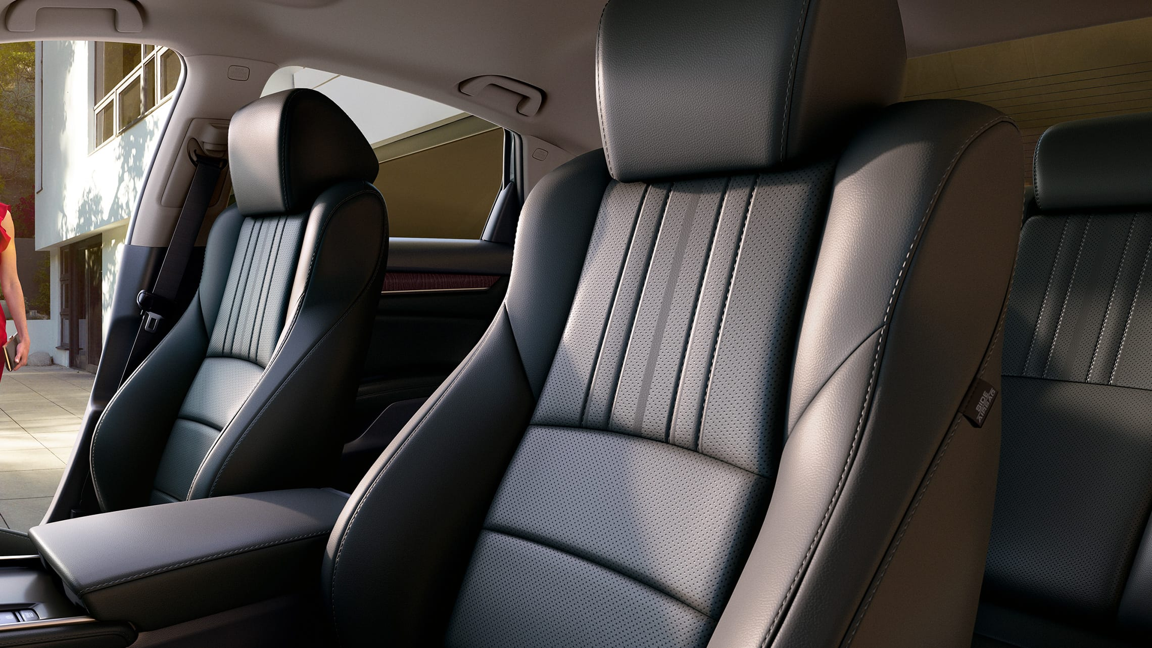 Interior driver-side view of leather-trimmed front seats in the 2020 Honda Accord Touring 2.0T with Black Leather.