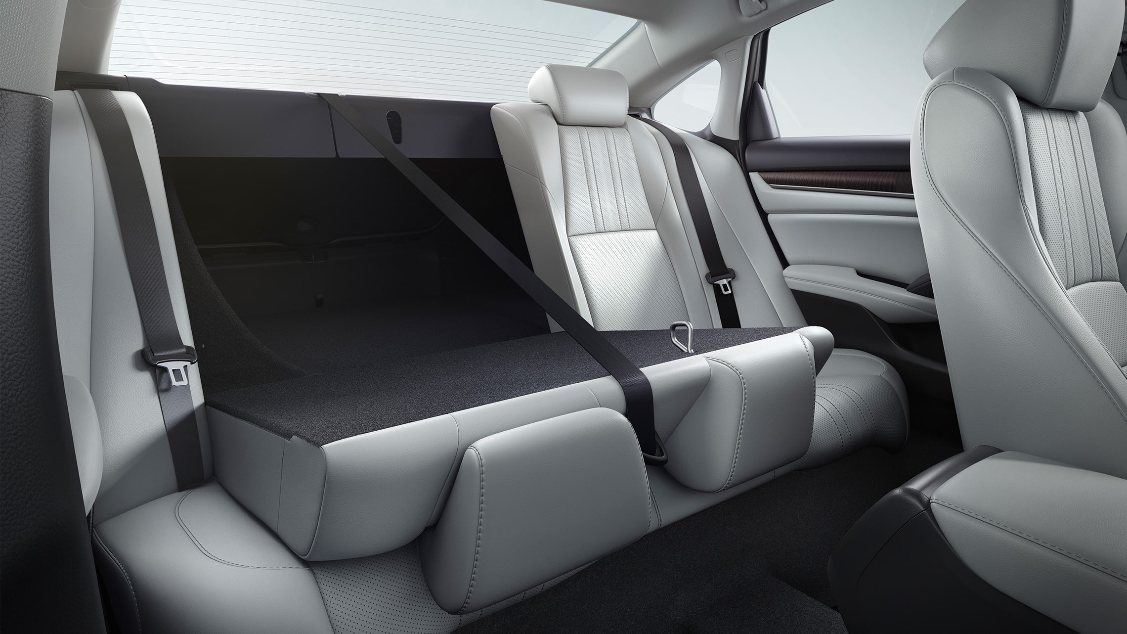 60/40 split fold-down rear seatback detail, shown partly folded down, in the 2020 Honda Accord Touring 2.0T with Ivory Leather.