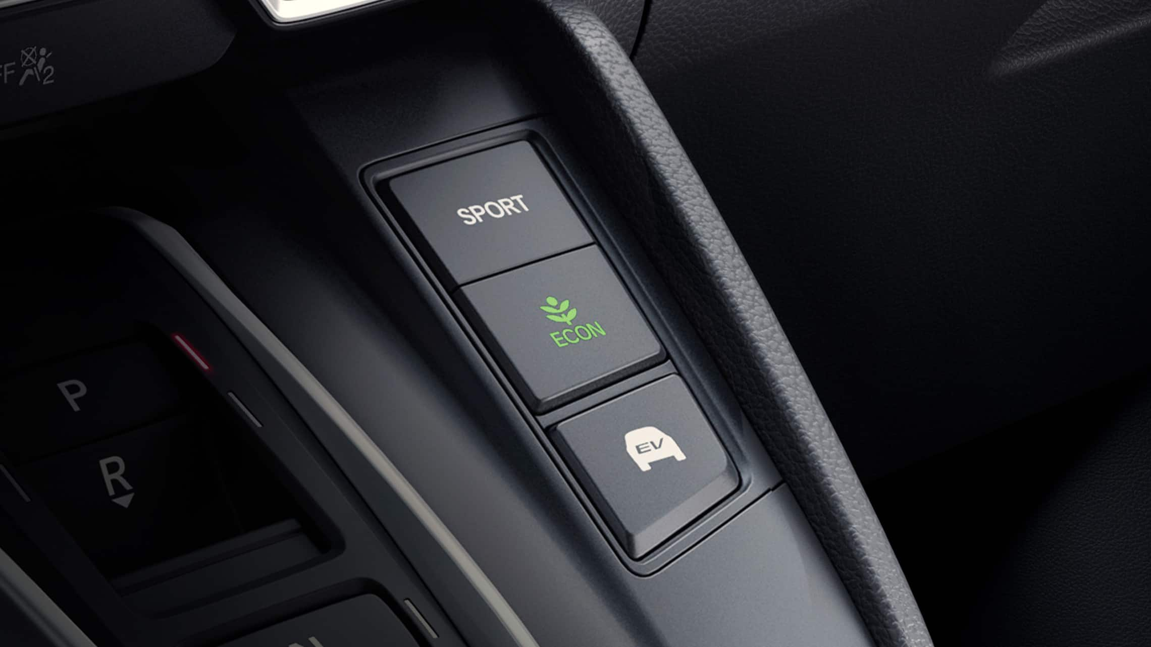 Detail view of the 2020 CR-V Hybrid Touring drive mode buttons.