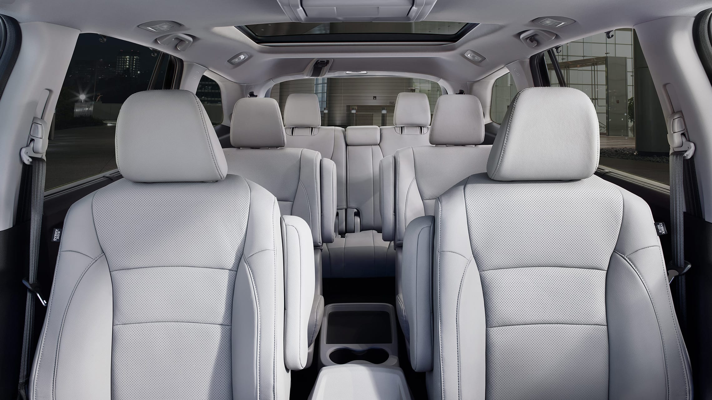 Interior cabin view of 2021 Honda Pilot Elite with Gray Leather and seating for 7.